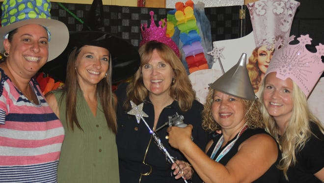 """Carmella Heer (center), principal, Max Leuchter School, celebrates back to school with members of her staff. Heer chose a """"Wizard of Oz"""" theme and declared, """"There's no place like Leuchter."""""""
