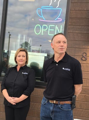 Owners Lori and Steve Walter speak Thursday at the grand opening ceremony for Ellianos in Prattville.