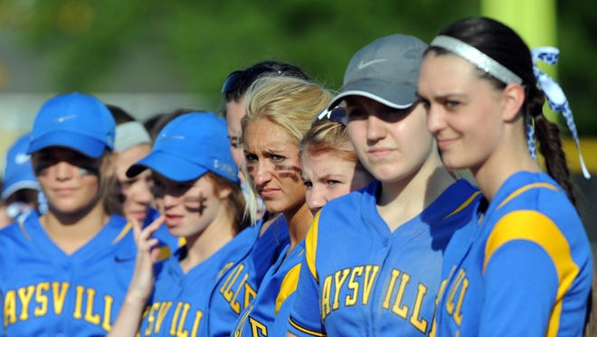 Maysville players wait for their championship medals following a 1-0 win against Buckeye Trail. The team's calm demeanor has been a key to their run to the Division II regional tournament.