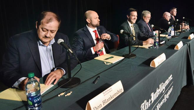 Candidates, from left, Don Blankenship, of Williamson,Bo Copley, of Delbarton; U.S. Rep. Evan Jenkins, R-W.Va., of Huntington, West Virginia Attorney General Patrick Morrisey, of Charles Town, Jack Newbrough, of Weirton, and Tom Willis, of Martinsburg, participate in a debatesponsored by The Intelligencer and Wheeling News Register at Wheeling Jesuit University in Wheeling, W.Va., Monday, April 23, 2018. The Republican candidates hoping to oust U.S. Sen. Joe Manchin in the fall took repeated turns attacking the incumbent Democrat's record while aligning themselves with President Donald Trump during the forum on Monday night.
