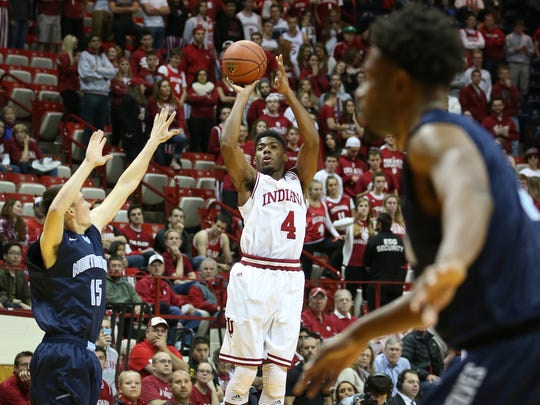 Hoosier Robert Johnson fires up a three pointer in the second half against the Timberwolves. Indiana hosted Northwood at Assembly Hall on Thursday, November 6, 2014.
