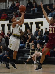 Abilene High's Triniti Wilson shoots a pull-up jumper