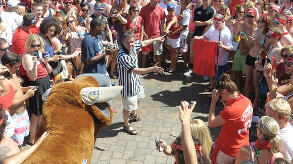 Dewey Beach regular Jay McCarthy stands as the matador as he faces the bull at last year's Running of the Bull event at The Starboard in Dewey Beach.