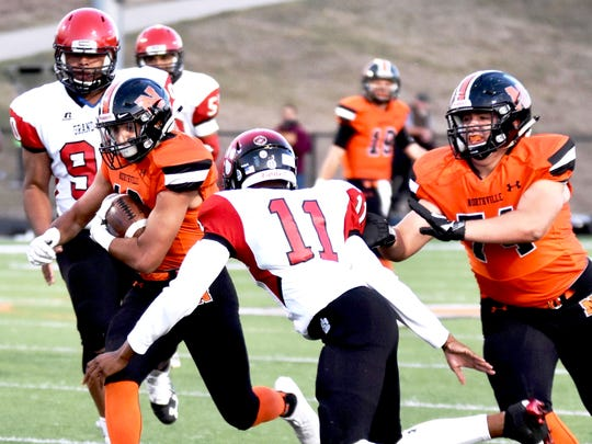 Northville's Abe Khoury breaks free with Grand Blanc's Jace Parrish (11) in pursuit.