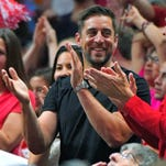 Aaron Rodgers cheers during the regional final between Wisconsin and Arizona in the NCAA Tournament.