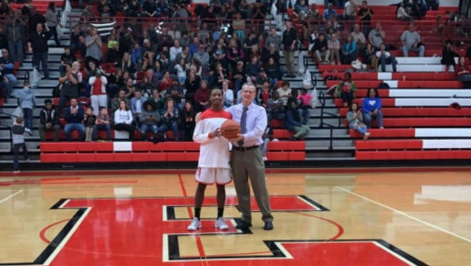 Erwin honored senior C.J. Thompson for scoring his 1,000th point on Friday.