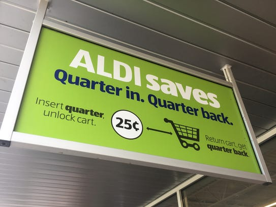 Shoppers wishing to use a shopping cart must insert