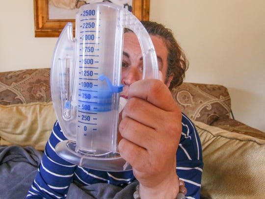 Amy Harrington seen using a spironeter at her home