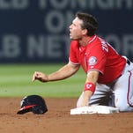 Ryan Zimmerman reacts after breaking his right thumb on a pickoff play Saturday against Atlanta.