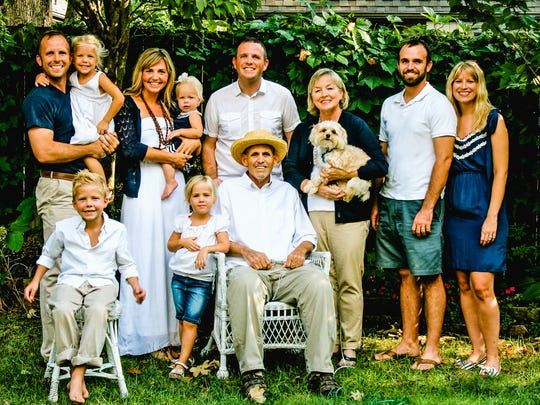 Mike Fortner, who died at age 61 in 2014, surrounded by members of the extended Fortner family.