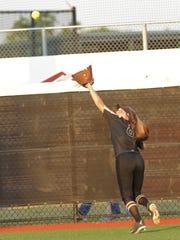 Clyde left fielder Brooke Widener (8) reaches for a