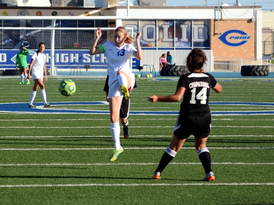Carlsbad's Lauryn Wade passes the ball down the right side Tuesday against Chaparral.