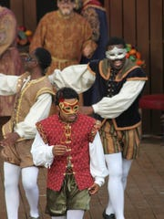 """Crystian Wiltshire as Romeo with Byron Coolie and Braden McCampbell (behind) in Kentucky Shakespeare's 2016 production of """"Romeo and Juliet."""""""