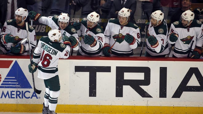 Minnesota Wild defenseman Jared Spurgeon (46) celebrates his goal with his teammates in the first period of an NHL hockey game against the Dallas Stars on Monday in St. Paul.