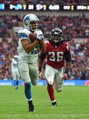 Detroit Lions wide receiver Golden Tate (15) catches the ball to score a touchdown during the NFL football game against Atlanta Falcons at Wembley Stadium, London, Sunday, Oct. 26, 2014.