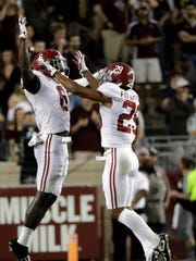 Alabama defensive back Minkah Fitzpatrick (29) celebrates with defensive back Hootie Jones (6) after intercepting a pass during the second half of an NCAA college football game against Texas A&M Saturday, Oct. 7, 2017, in College Station, Texas. Alabama won 27-19.