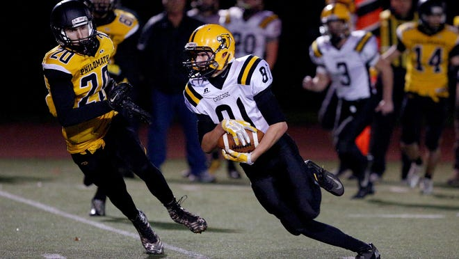 Cascade wide receiver Michael Biddington (81) runs after a catch against Philomath during the quarterfinals of the OSAA Class 4A state playoffs, Friday, November 13, 2015, at Corvallis High School in Corvallis, Ore. Cascade won the game 35-34.