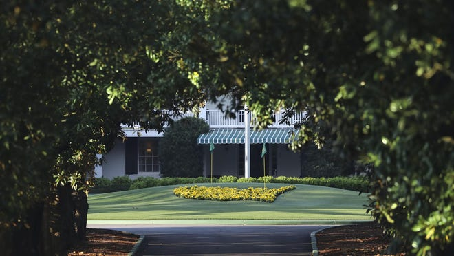 Augusta National Golf Club is seen down Magnolia Lane on Monday, appearing well-manicured on what would have been the first practice round for the Masters. Instead the Masters is now scheduled for Nov. 12-15.