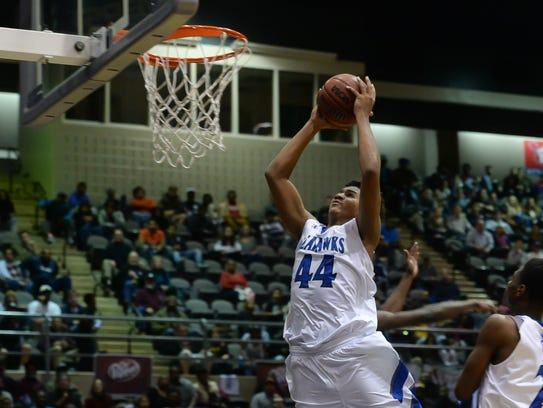Former Decatur forward Keve Aluma signed with Division I Wofford following his high school graduation.