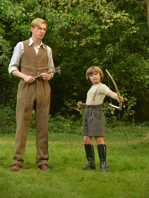 A.A. Milne (Domhnall Gleeson) enjoys a day out with son Christopher Robin (Will Tilston).