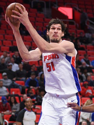 Pistons center Boban Marjanovic (51) grabs a rebound during the second quarter of the Pistons' 103-84 loss on Tuesday, Dec. 12, 2017, at Little Caesars Arena.