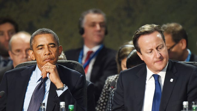 President Obama and British Prime Minister David Cameron attend a meeting on the second day of the NATO 2014 Summit at the Celtic Manor Resort in Newport, South Wales, on September 5, 2014. NATO leaders are expected to announce a raft of fresh sanctions against Russia on Friday over its actions in Ukraine, although hopes remain that a ceasefire can be forged at peace talks in Minsk on the same day.