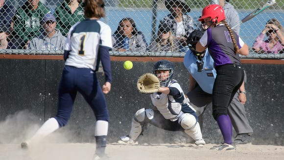 Bainbridge softball catcher Maddie Loverich joined five other West Sound players on the Washington State Softball Coaches Association all-state team.