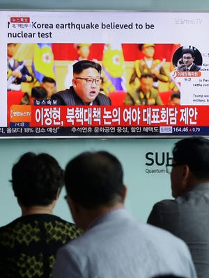 """People watch North Korean leader Kim Jong Un in Seoul, South Korea, on Sept. 9, 2016, when North Korea said it conducted a """"higher level"""" nuclear warhead test explosion."""