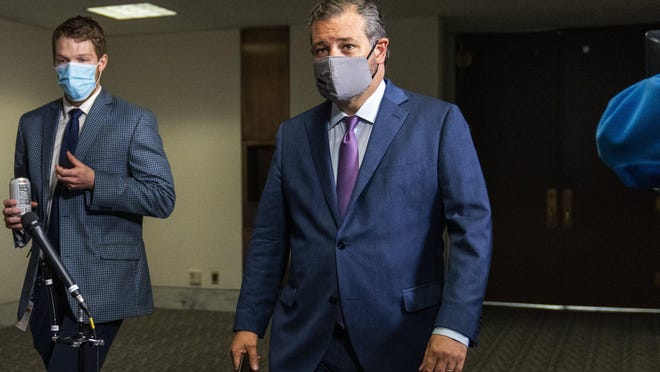 Sen. Ted Cruz, R-Texas, right, leaves a Senate Republican policy meeting on Capitol Hill. Cruz said Friday he favors replacing Supreme Court Justice Ruth Bader Ginsburg, who died Friday, before the Nov. 3 election.