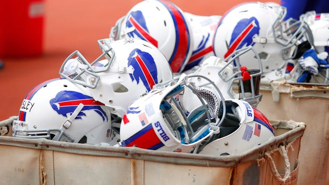 Buffalo Bills helmets are piled into bins following their NFL football organized team activity in Orchard Park, N.Y., Thursday, May 29, 2014.