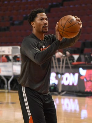 Chicago Bulls guard Derrick Rose (1) warms up before the game against the Detroit Pistons at the United Center.