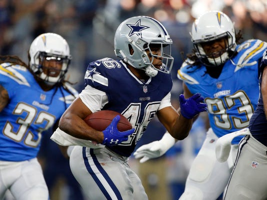 Dallas Cowboys' Alfred Morris (46) carries the ball as Los Angeles Chargers' Tre Boston (33) and Darius Philon (93) pursue in the first half of an NFL football game, Thursday, Nov. 23, 2017, in Arlington, Texas. (AP Photo/Ron Jenkins)