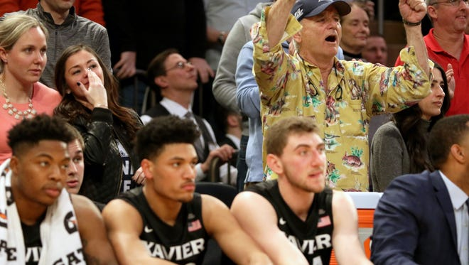 Actor and comedian Bill Murray, standing behind the Xavier bench, yells for the Musketeers during the final minutes of the game against Creighton in the semi-finals of the Big East Conference Tournament in New York City Friday March 10, 2017. Xavier lost 75-72.
