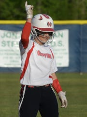North DeSoto's Emily Henderson gives a high sign after