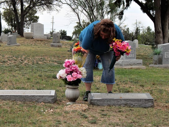 Friends and family gathered at the gravesite of Sally