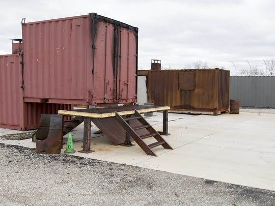 A set of storage containers used for fire rescue training in a multi-use training facility in Hamilton County, Noblesville, Friday, April 10, 2015. The facility, which currently occupies 90 acres of rural Hamilton County, includes space for a proposed set of new set of buildings, weapons range and expanded water rescue facilities.