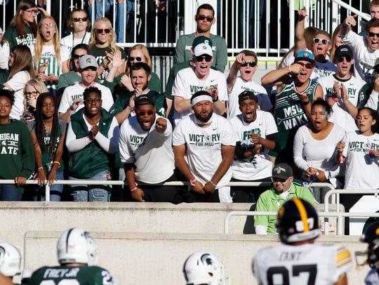 MSU football fans cheer on the Spartans against Iowa