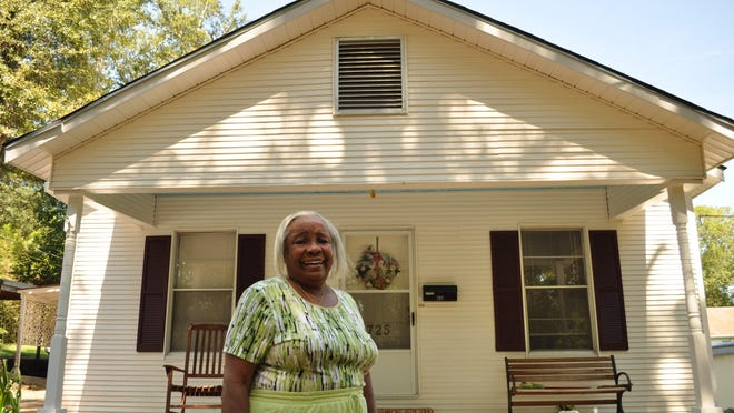 Celia Harris stands in front of her Pineville home which she believes was an answer to her prayers to God after she fled New Orleans because of Hurricane Katrina.