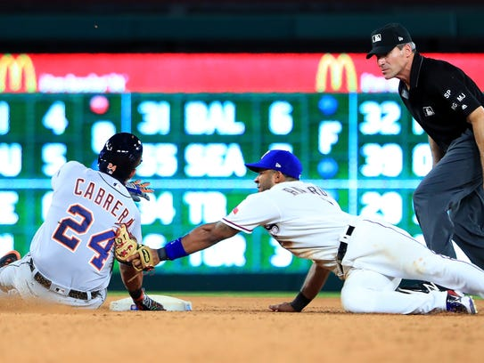 Rangers shortstop Elvis Andrus tags out Tigers designated