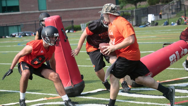 Members of the Mamaroneck High School football team on the first day of practice at the school's field on Aug. 17, 2015.