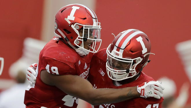 Indiana's Greg Gooch (49) celebrates with Robert McCray III after Gooch sacked Rutgers quarterback Giovanni Rescigno during the first half of an NCAA college football game, Saturday, Nov. 18, 2017, in Bloomington, Ind. (AP Photo/Darron Cummings)