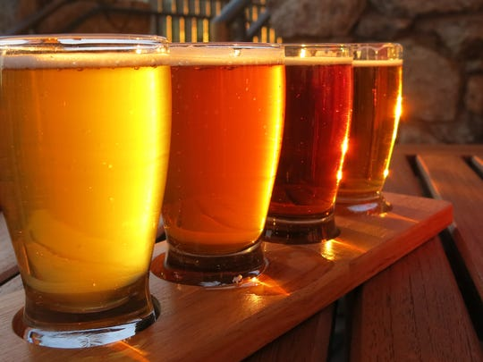 Starting with four main ingredients, brewers create a wide variety of beers.  Getty Images/iStockphoto Beer flight with yellow, orange, and brown hues.  Different flavors and types of beers.