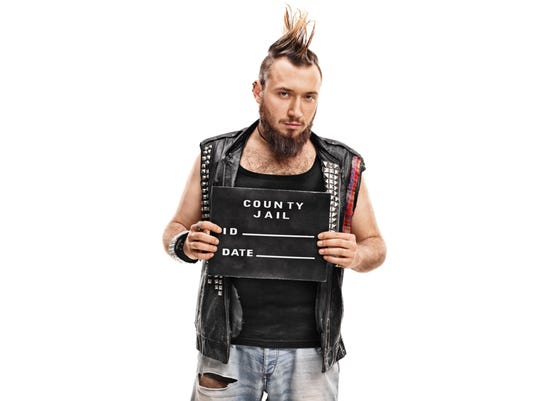Punk rocker posing for a mug shot