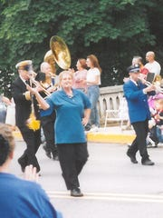 Bonnie Zinn leads the Shippensburg Band in a parade in 2003.