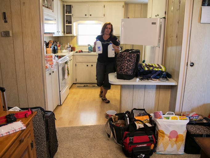 Sue Pachalis packs up her food and some frozen water