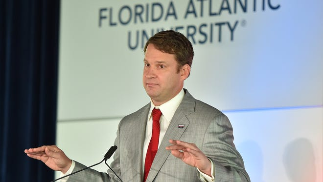 Florida Atlantic coach Lane Kiffin speaks to the media at FAU Football Stadium.