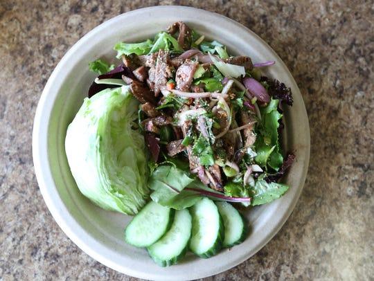 Spicy Grilled Pork Salad ($12) is served at Big Blue