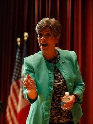 Sen. Joni Ernst acknowledges a face in the crowd Friday, March 17, 2017, during her Polk Count town hall meeting in Sheslow Auditorium at Drake Universtiy.