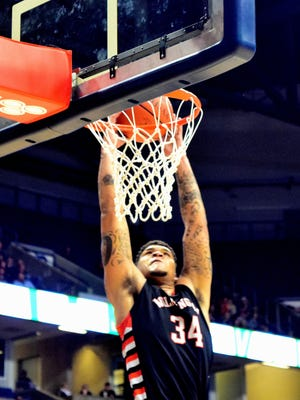 Jarron Cumberland reaches for the dunk for Wilmington at the regional final, March 12, 2016.