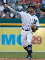Tigers shortstop Dixon Machado (49) pitches to first